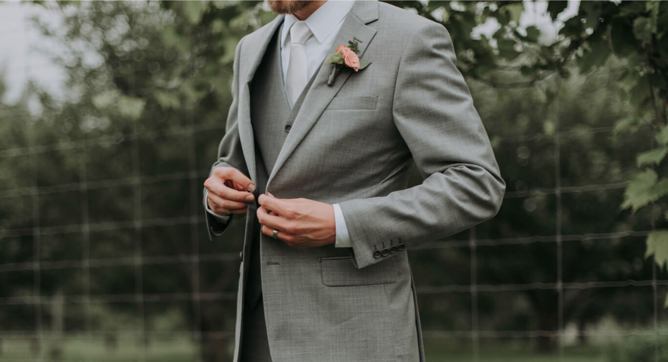 Photo of man in a gray suit